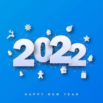 Kartka wesołych świąt i szczęśliwego nowego roku 2022 z ozdobami świątecznymi na niebieskim tle. ilustracja wektorowa