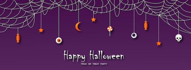 Kartka z życzeniami happy halloween w stylu cięcia papieru cukierkowa czaszka z gwiazdami i księżycem wisi na pajęczynie
