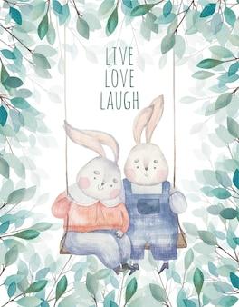 Kartka z życzeniami urocze króliczki kochanków jeżdżą na huśtawce wśród liści i drzew, ilustracja dla dzieci na walentynki