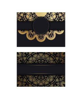 Kartka z życzeniami w kolorze czarnym ze złotym ornamentem mandala na gratulacje.