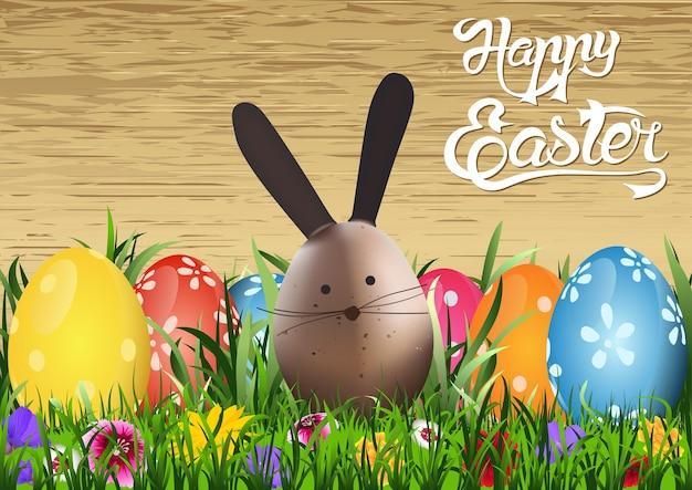 Kartka z życzeniami wesołych świąt z zajączkiem i kolorowymi jajkami wielkanocnymi