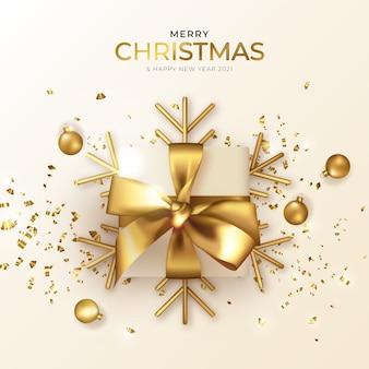 Kartkę z życzeniami bożego narodzenia i nowego roku z pięknym realistycznym prezentem