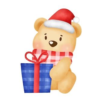 Kartkę z życzeniami na boże narodzenie i nowy rok z uroczym misiem i prezentem świątecznym w stylu akwareli.