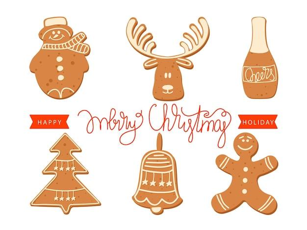 Kartkę z życzeniami świątecznymi i szczęśliwego nowego roku ze świątecznymi ciasteczkami i napisem