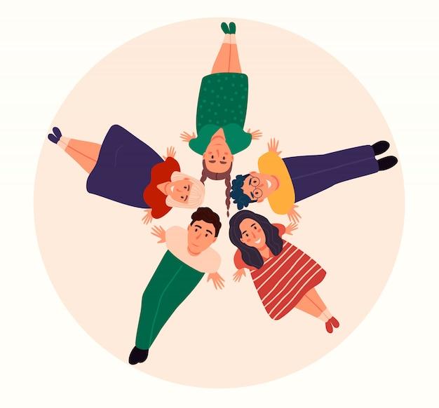 Kartkę z życzeniami szczęśliwego dnia życzliwego z różnorodną grupą ludzi, trzymając się za ręce.