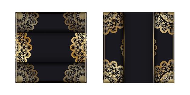 Kartkę z życzeniami w kolorze czarnym ze wzorem złota mandali do projektowania.