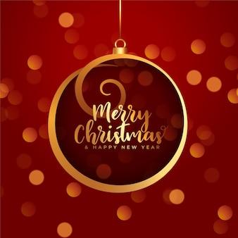 Kartkę z życzeniami wesołych świąt i nowego roku z wiszącą kulą i brokatem niewyraźne światła