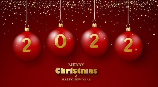 Kartkę z życzeniami wesołych świąt i szczęśliwego nowego roku 3d realistyczne czerwone bombki i złote konfetti