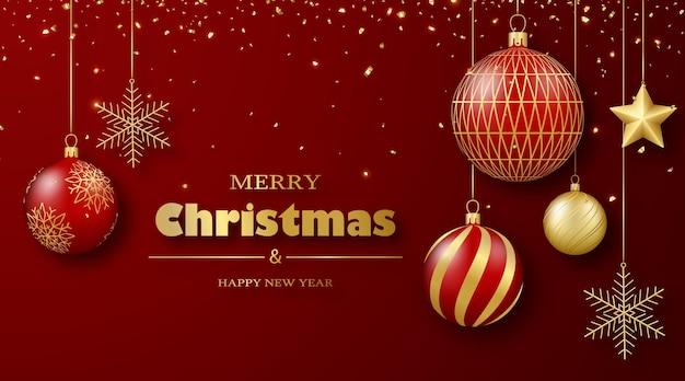 Kartkę z życzeniami wesołych świąt i szczęśliwego nowego roku złote i czerwone bombki i konfetti