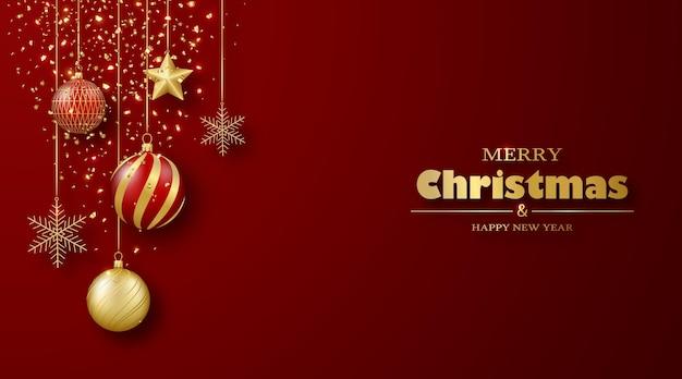 Kartkę z życzeniami wesołych świąt i szczęśliwego nowego roku złote i czerwone kulki płatki śniegu gwiazdy na wstążkach