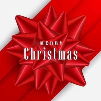 Kartkę z życzeniami wesołych świąt iwith czerwoną kokardą