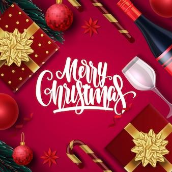 Kartkę z życzeniami wesołych świąt z napisem i świątecznych dekoracji
