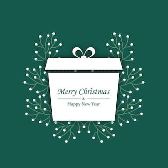 Kartkę z życzeniami wesołych świąt z prezentem i oddziałami w stylu płaski