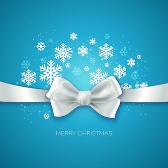 Kartkę z życzeniami wesołych świąt z wstążką z białą jedwabną kokardą