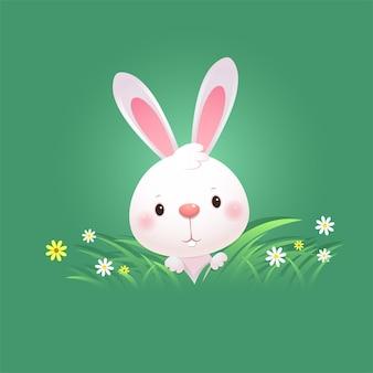 Kartkę z życzeniami z białym zajączkiem wielkanocnym. śliczny królik ukrywa się w zielonej trawie