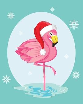 Kartkę z życzeniami z flamingiem. boże narodzenie w tle