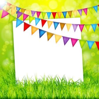 Kartkę z życzeniami z kolorowymi flagami i zieloną trawą