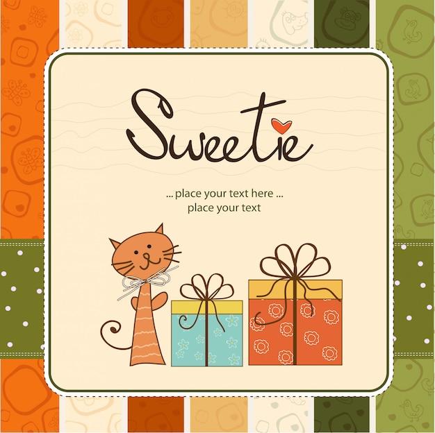 Kartkę z życzeniami z kotem i prezenty