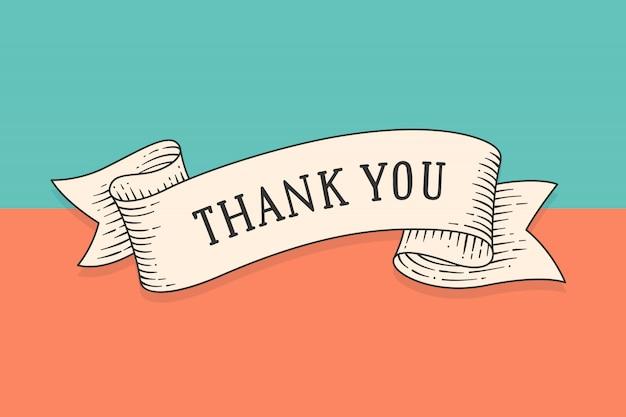 Kartkę z życzeniami ze wstążką i frazą dziękuję