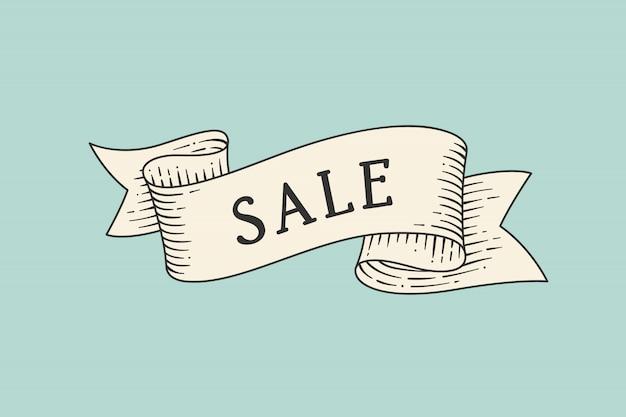 Kartkę z życzeniami ze wstążką i słowo sprzedaż