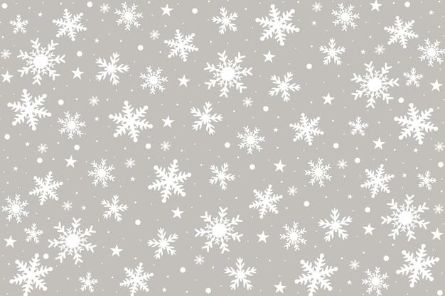 Kartki świąteczne z białymi płatkami śniegu.