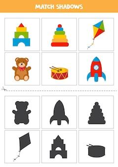 Karty dopasowujące cień dla dzieci w wieku przedszkolnym. zestaw kolorowych zabawek.