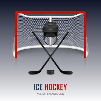 Kask hokejowy, krążek, kije i bramka.