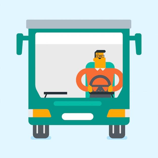 Kaukaski kierowca autobusu siedzi przy kierownicy.