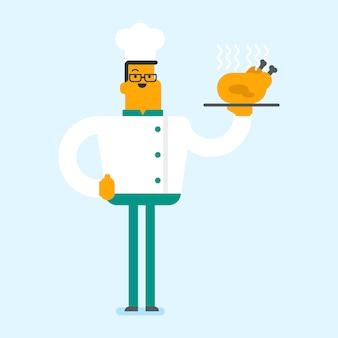 Kaukaski szef kuchni trzyma pieczonego kurczaka.