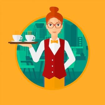 Kelnerka trzyma tacę z filiżankami kawy.