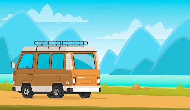 Kemping. minivan w górskiej scenerii i nad jeziorem. wycieczka do natury.