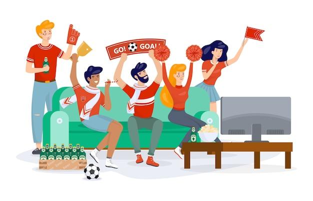 Kibic w strojach sportowych oglądając piłkę nożną w telewizji
