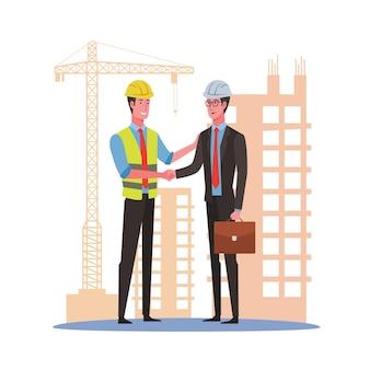 Kierownik projektu budowlanego z biznesmenem uścisk dłoni na placu budowy