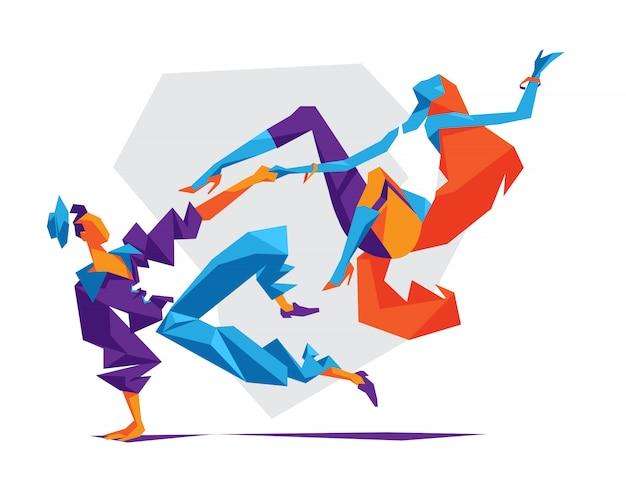 Kilka nowoczesnych freestyle tancerzy kobiet i mężczyzn.