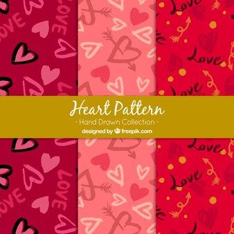Kilka ręcznie rysowane wzory z pięknych serc i strzały