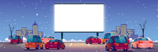 Kino plenerowe, kino samochodowe z samochodami na parkingu w zimie.