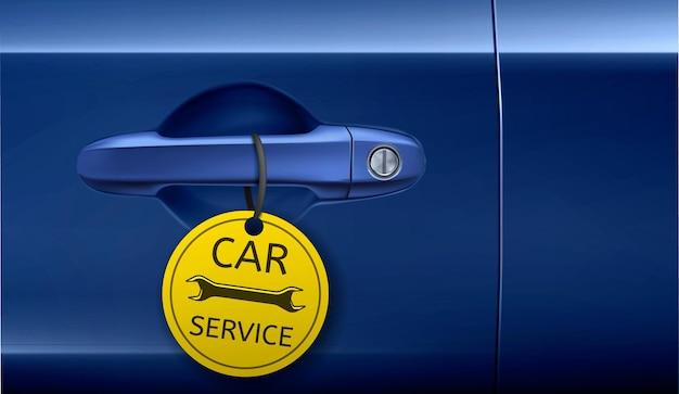 Klamka do drzwi z banerem reklamowym serwisu samochodowego z żółtą etykietą