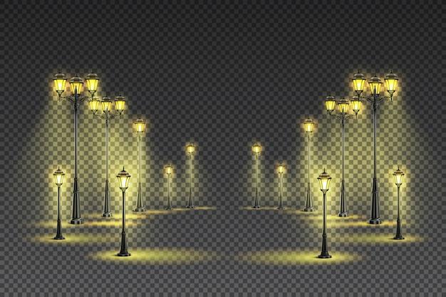 Klasyczne żółte oświetlenie zewnętrzne ogrodowe przy ulicy z dużymi i małymi latarniami