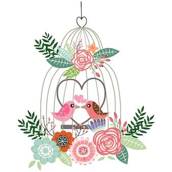 Klatka dla ptaków pełna z kwiatem