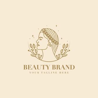 Kobiece kwiatowe logo urody twarzy kobiety z wieńcem laurowym do marki salonów spa do pielęgnacji włosów