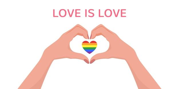 Kobiece ręce tworzące kształt serca z sercem flagi lgbt w środku i napisem love is love