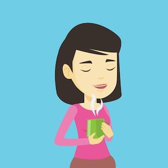 Kobieta cieszy filiżankę kawy.