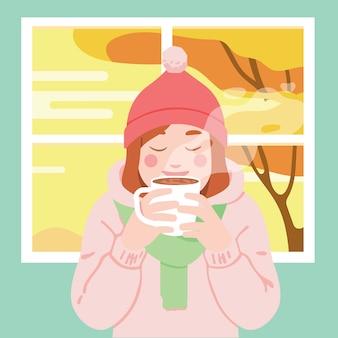 Kobieta cieszyć się kawą / herbatą / czekoladą w domu jesienią