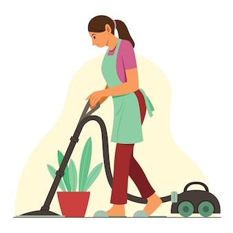 Kobieta czyści podłogę odkurzaczem