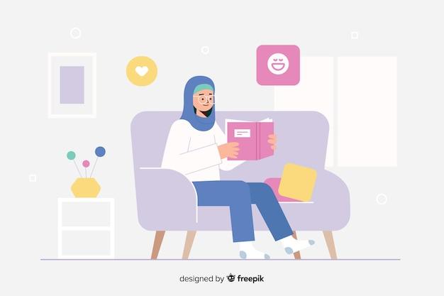 Kobieta czyta książkę w jej domowej lądowanie stronie