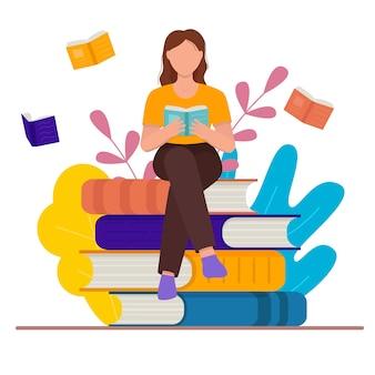 Kobieta czytająca książkę. kobieta siedzi na książkach