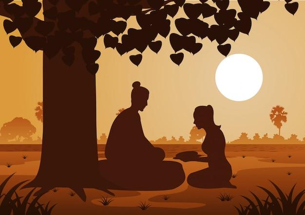 Kobieta dająca jedzenie panu buddy przed oświeceniem w dzień vesaka