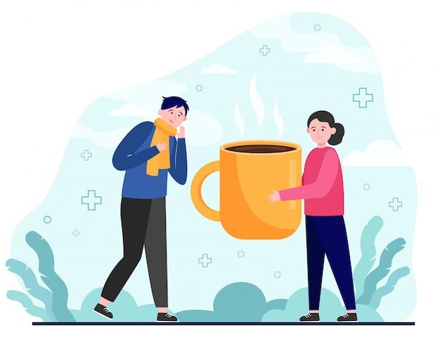 Kobieta daje gorącą herbatę choremu człowiekowi