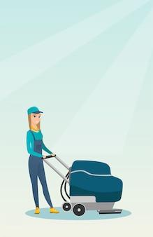 Kobieta do czyszczenia podłogi sklepu za pomocą maszyny.