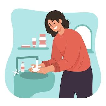 Kobieta do mycia rąk mydłem pod bieżącą wodą